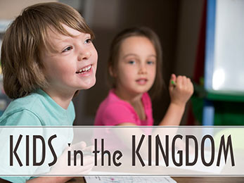 Church Art PowerPoint image of boy and girl coloring and caption Kids in the Kingdom