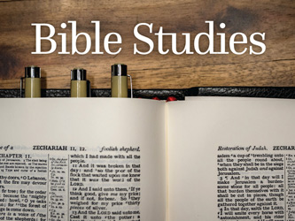 Bible Clip-Art photograph of open Bible with pens and Bible Studies caption