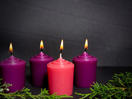 Four burning Advent candles purple and red as background photo