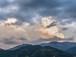 Image of clouds over a mountain landscape perfect for a church worship background