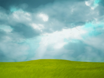 Worship background with green grass and sun rays coming out of a cloudy sky
